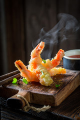 Closeup of shrimp in tempura with sour sauce and sweet