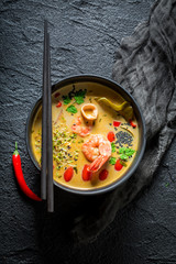 Closeup of Tom Yum soup with shrimps and coconut milk