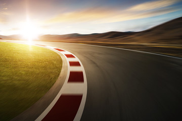 Wall Mural - Motion blurred racetrack with mountain background , warm mood