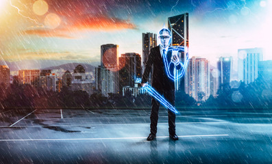 Businessman turned into thunder warrior,holding a lightning sword and shield ,preparation, protection, precaution and security in business concept .