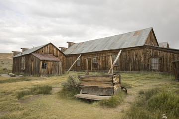 Wooden well outside  barn in field, Bodie