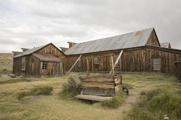Wooden well outside  barn in field, Bodie