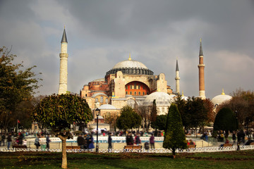 View of Hagia Sophia Aya Sofia, Christian patriarchal basilica, imperial mosque and now a museum, Istanbul, Turkey on a cloudy autumn day, people with motion blur