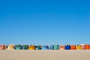 Traditional beach umbrellas in Trouville, Normandy France