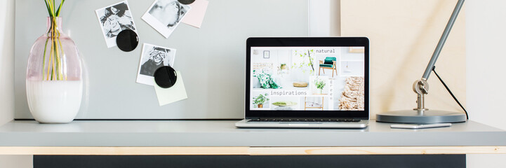 Simple pastel workspace with laptop