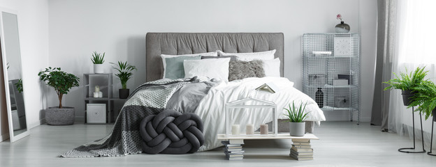 Grey braided pillow near to candles