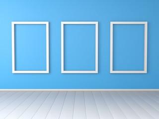 Three white empty frames on blue wall