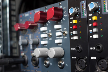 Microphone preamps for recording. Selective focus. Recording studio equipment.