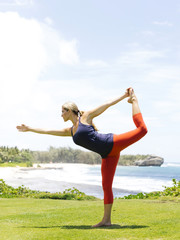 USA, Hawaii, Kauai, Woman stretching on sunny day