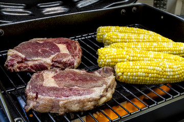 Steak and Corn on Hot Grill