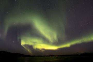 Aurora borealis above snowy islands of Lofoten,Norway