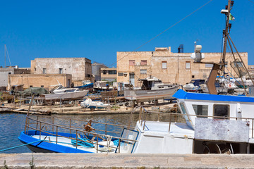 Mazara del Vallo (Italy) - Day view of canal, fishing boats and downtown