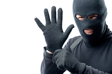 The criminal puts on a glove. Preparation for robbery
