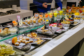 Dessets consisting of cakes, mousses and fruit at the buffet of a hotel restaurant