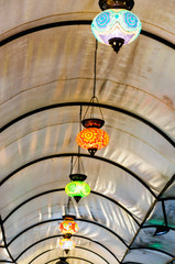 Glass lampshades hanging from the roof of Fethiye Market, Turkey