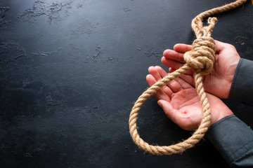 Holds a rope loop in his hands - the concept of suicide is not an option