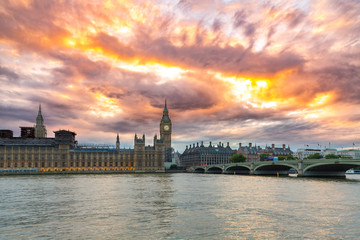 Big Ben and the Palace of Westminster, dramatic sunset sky, landmark of London, UK