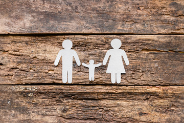 Paper family on a wooden background