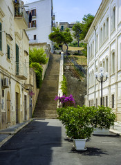 Apulia, Vieste old town, south Italy.Typical italian medieval narrow street.
