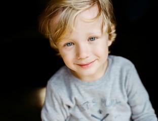 Cute handsome little blond boy