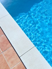 tiled edge of swimming pool