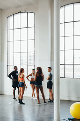 Professional coach doing a class in the gym.