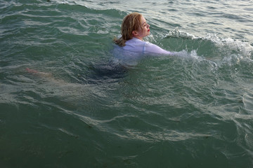 business woman sinking into the sea