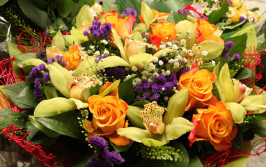 Flower bouquet with orchids and roses