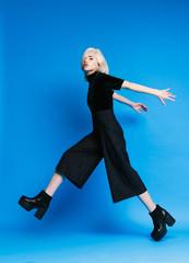 Stylish blonde girl steps forward