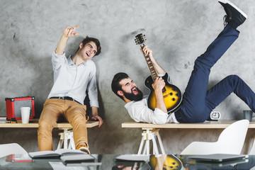 European men playing with guitar