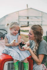 Portrait of a beautiful woman and her daughter captured in the rural backyard