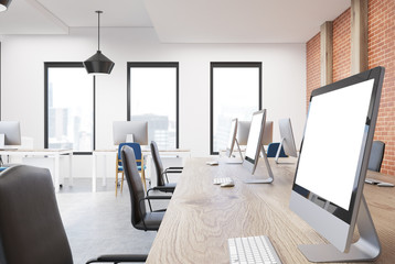 Open space office interior, computer screen