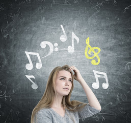 Blonde girl scratching head, music notes