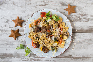 bowtie pasta with sausage and vegetables on plate top view