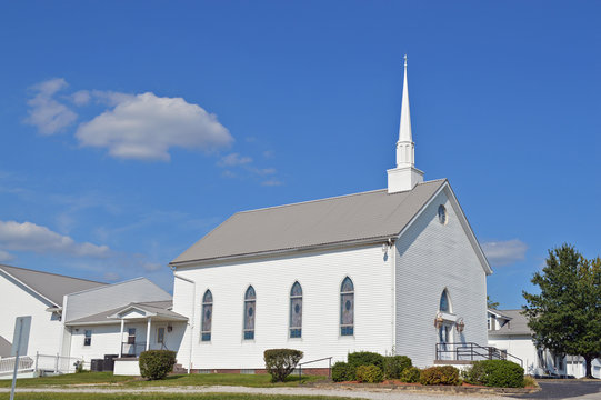 Little white church with a beautiful blue sky background in a country setting