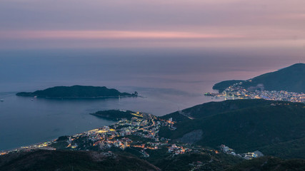Evening skyline of coastline with Budva and Becici tourist resorts