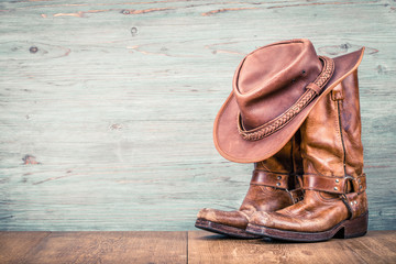 Wild West retro leather cowboy hat and old boots. Vintage instagram style filtered photo