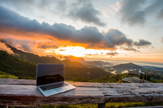 Freelancer office in mountain cafe. Online webinar everywhere via 4ginternet with mountain and sunrise background.