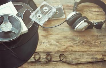 Retro music background, vinyl record, reel, audio cassettes