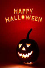 Happy Halloween pumpkin, funny face on red background