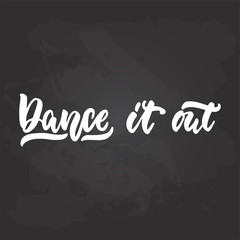 Dance it out - lettering dancing calligraphy quote drawn by ink in white color on the black chalkboard background. Fun hand drawn lettering inscription.
