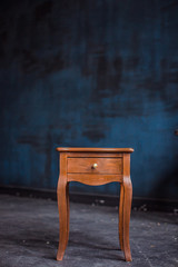 Interior of a room with nightstand a blue wall background