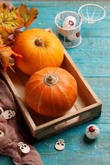 Image of pumpkin, maple leaves