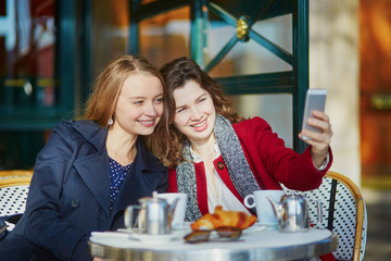 Two young girls in Parisian outdoor cafe