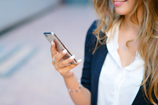 Phone in the hands of the girl