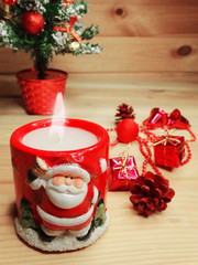 christmas candle decoration and copy space on wooden background