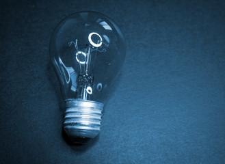 Incandescent lamp on a dark background.