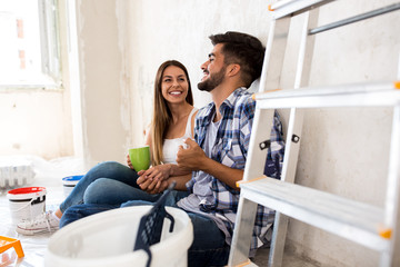 Happy young couple renovation new home