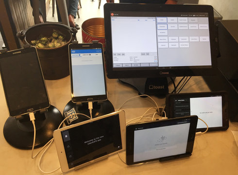 Electronic devices are shown at the food counter at Presidio Pizza Company in San Francisco