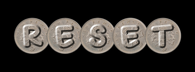 RESET – Five new pence coins on black background